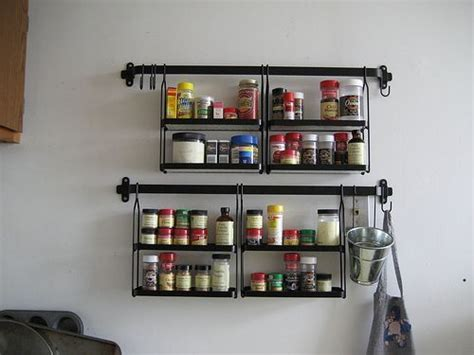 black metal wall mounted spice rack with eight