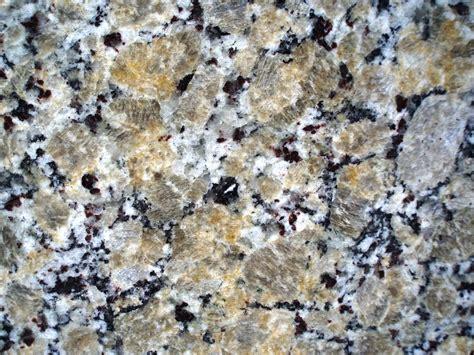 color spotlight beige butterfly granite countertop