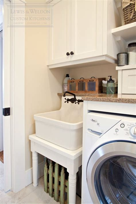 pretty slop sink trend raleigh transitional laundry room