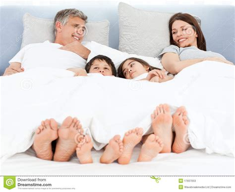 lying down in bed family lying down in their bed stock photos image 17937053