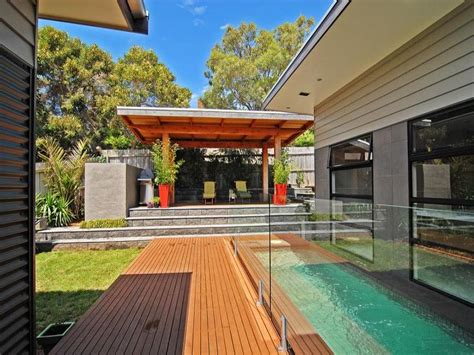 in ground pool design using grass with bbq area outdoor furniture setting pool photo 113560