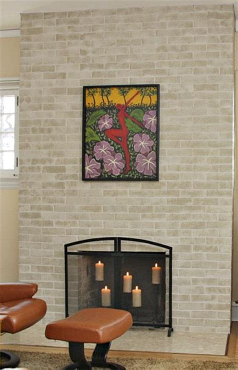 freshen a dated brick fireplace by painting the it light bright colors that complement the room
