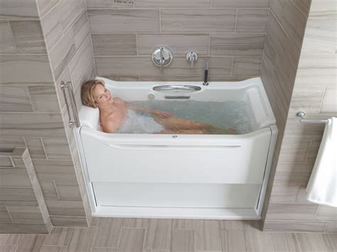 bathtub com kohler k 1914 grb 0 elevance bubblemassage rising wall