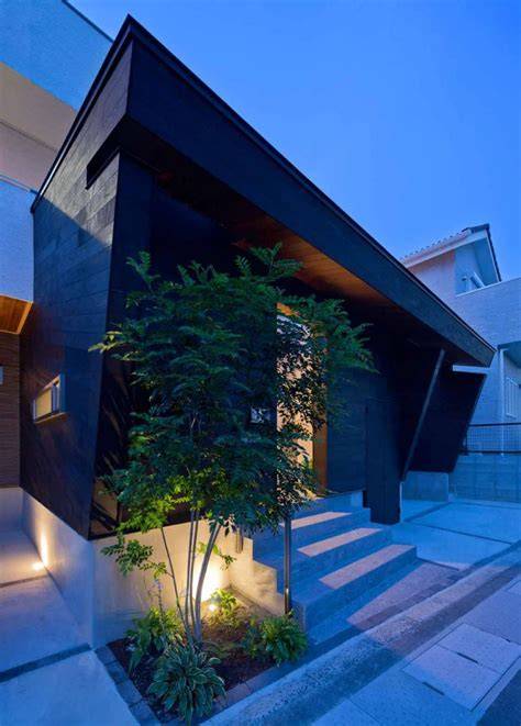 minimalist japanese residence blends privacy   airy