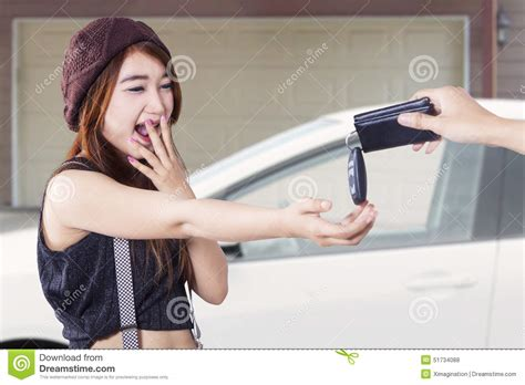 a woman gets a new get a new car at garage stock photo image