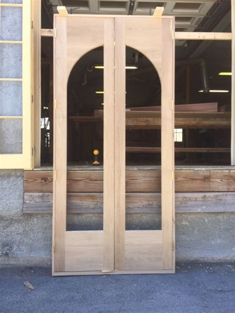 custom built wood exterior doors entryway arch top wood custom arched top doors jim illingworth millwork llc