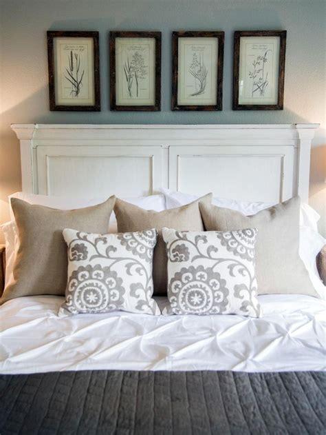 Joanna Gaines Master Bedroom Comforter framed floral prints are displayed above a wood panel