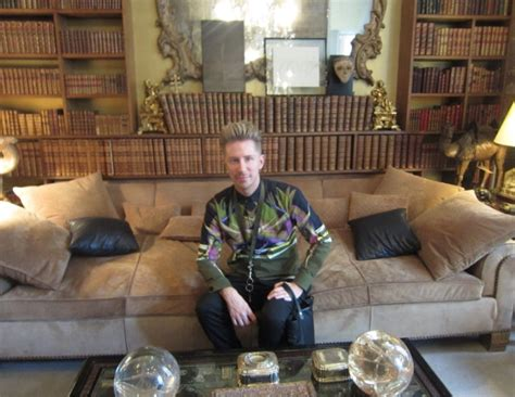 coco chanel sofa price kyle anderson sitting on the quilted suede sofa that
