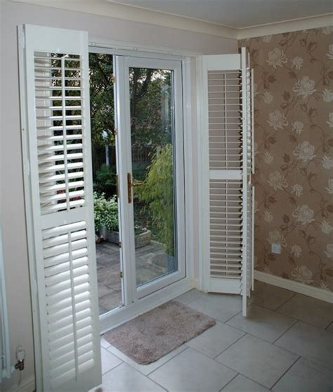 window coverings for patio sliding doors patio door shutters these plantation shutters are of the