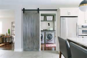 barn door laundry room laundry room with gray barn door on rails cottage