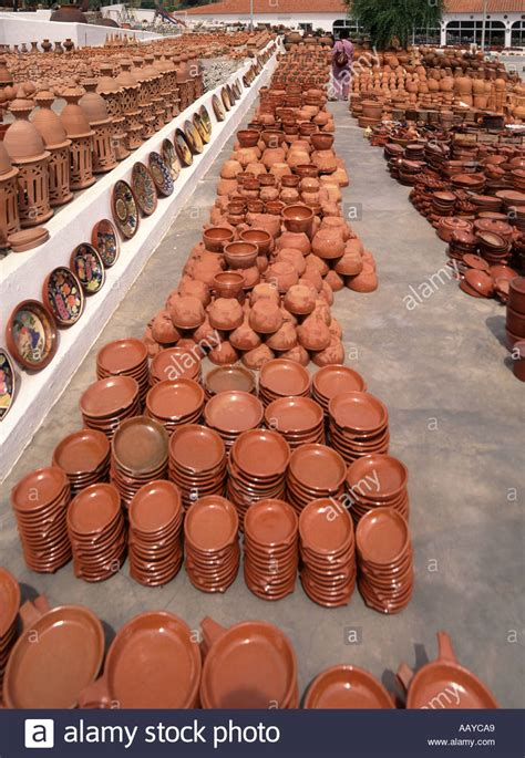 algarve large stock of clay pots and glazed plates on
