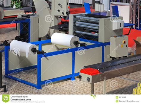 Toilet Paper Roll Machine - toilet paper machine stock photo image of printing