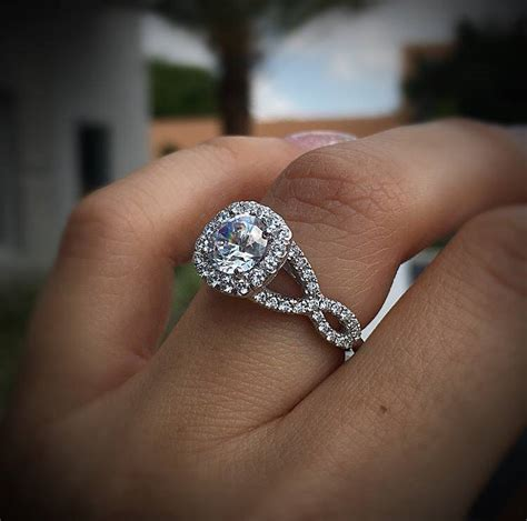 solitaire  halo engagement rings raymond lee jewelers