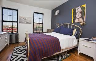 Bedroom With Navy Accent Wall A Navy Blue Accent Wall Is The Focal Point Of This Bedroom