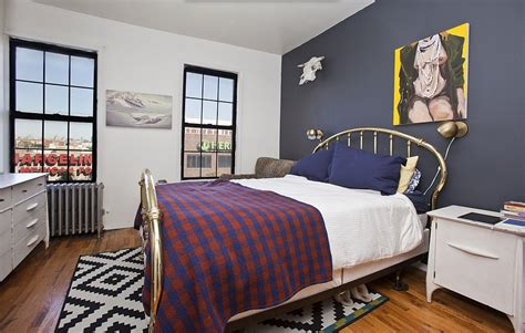 bedroom focal wall a navy blue accent wall is the focal point of this bedroom