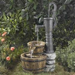 outdoor water pump half whiskey barrel style water