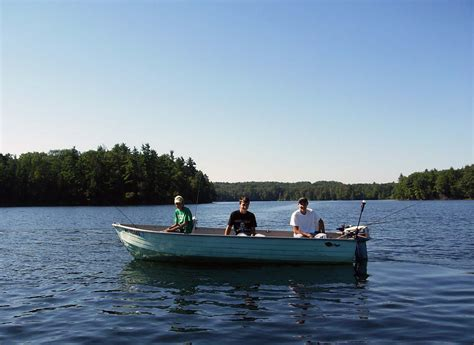 pictures of boats on the lake three men in a boat fishing on a lake drawing tips and