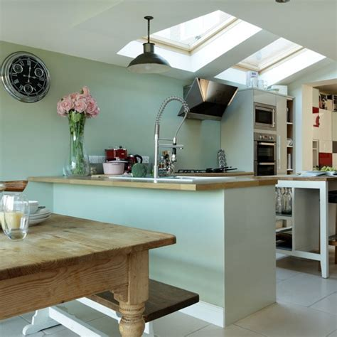 pale green kitchen cabinets pale green and oak kitchen housetohome co uk