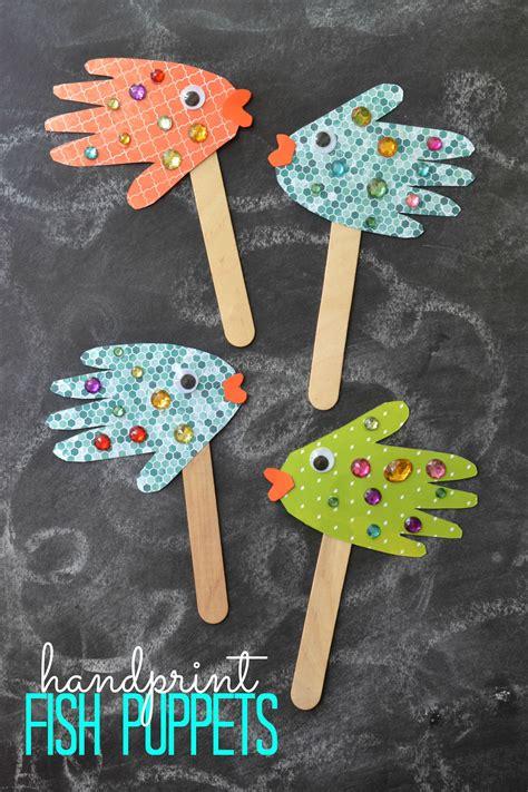 kindergarten crafts easy craft handprint fish puppets puppet craft