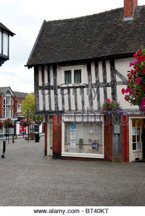 a medieval building housing shops in lincoln high street