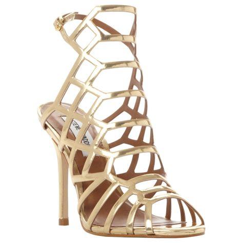 Steve Madden Skales Gold Steve Madden Caged Heels Sepatu Branded lyst steve madden slithur caged stiletto heel sandals in metallic