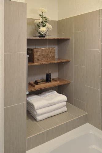 Vertically Laid 12x24 Tile Design. Like the shelves for