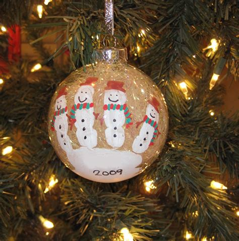 diy snowman handprint ornaments add a poem these aren t