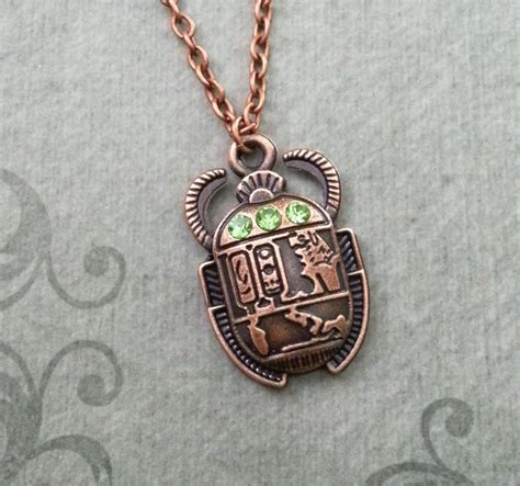 scarab beetle necklace scarab jewelry green eyed scarab charm