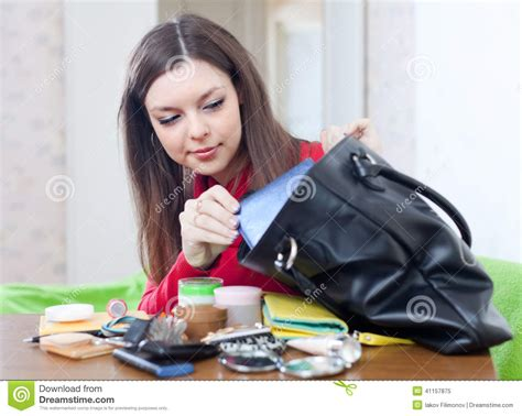 What Are Searching For On Looking For Something In Purse Stock Photo