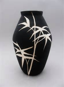 black and white painted and carved ceramic vase