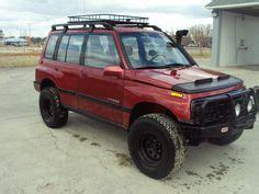 "lifted 1995 suzuki sidekick 31"" mud tires, sound system"