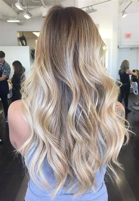 are roots with blonde hair in style balayage with brown roots