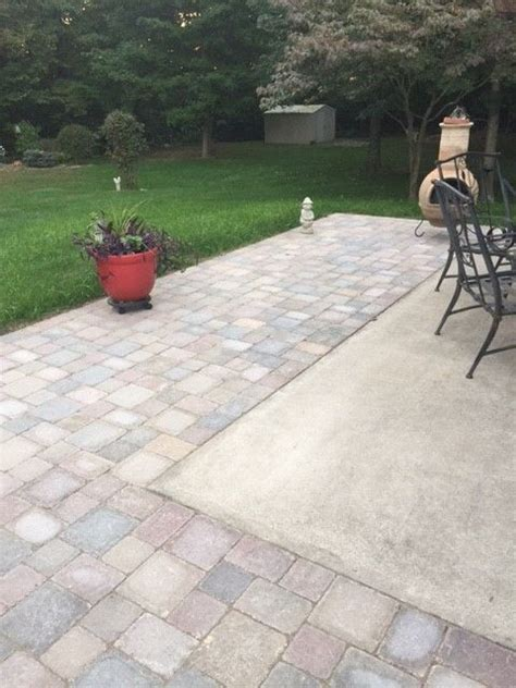 Concrete Patio Pavers by Extending Concrete Patio With Pavers Outdoor Ideas And