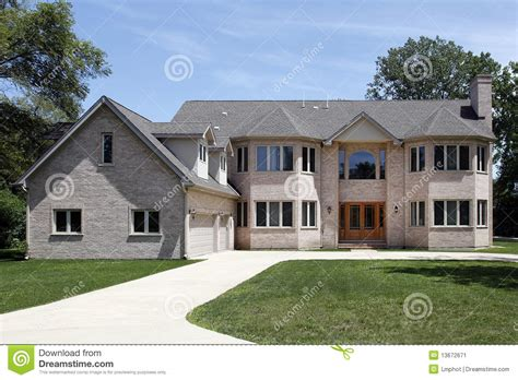 house with 3 car garage large brick home with three car garage stock image image