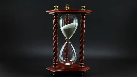 Decorative Hourglass by Blue Sand Pours Inside Wooden Framed Hourglass Measured