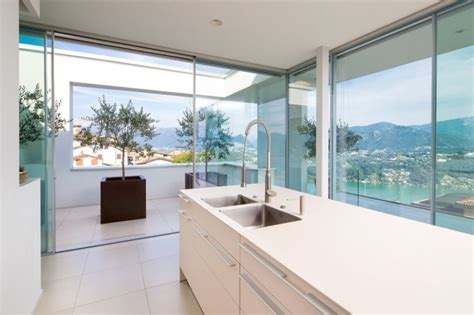 kitchen view luxurious swiss villa sizzles with spectacular views and a plush interior