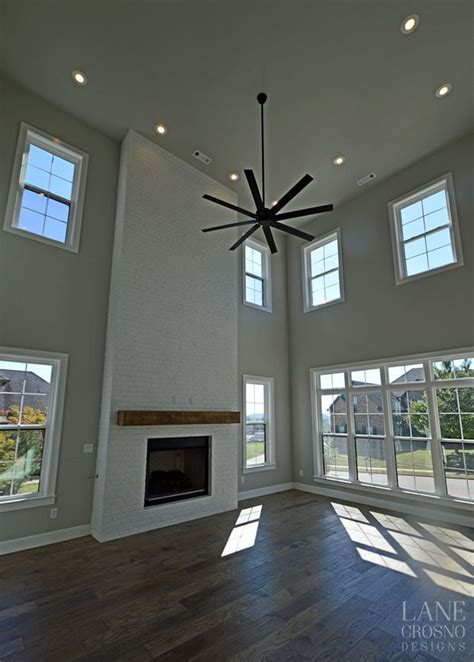 contemporary living room tall ceilings  story living