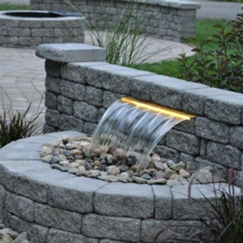 Exceptionnel Petite Fontaine De Jardin #4: fontaine-de-jardin-jardiland-petit-entourer-de-peirre.jpg