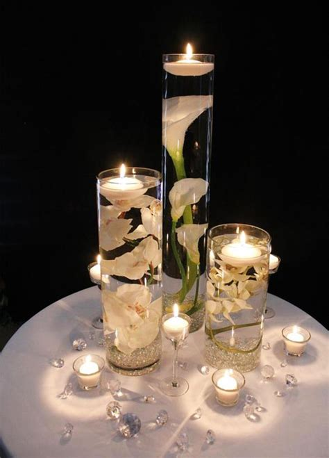 37 Floating Flowers And Candles Centerpieces Shelterness Candle And Flower Centerpieces