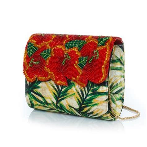 Bagtitude Hibiscus Tosca Clutch Bag earrings amal clooney style