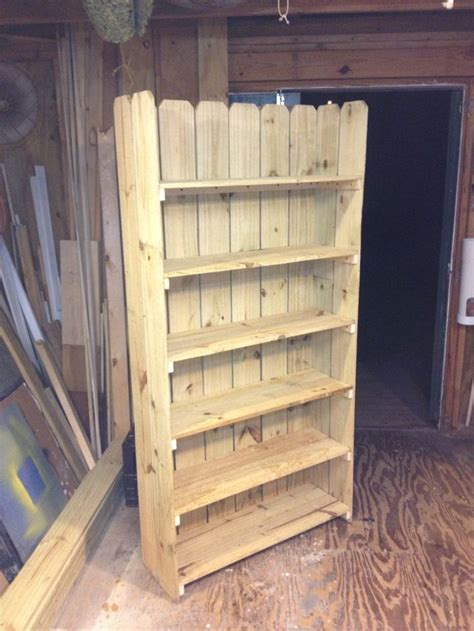 bookshelf made from leftover fence boards and 16 inch