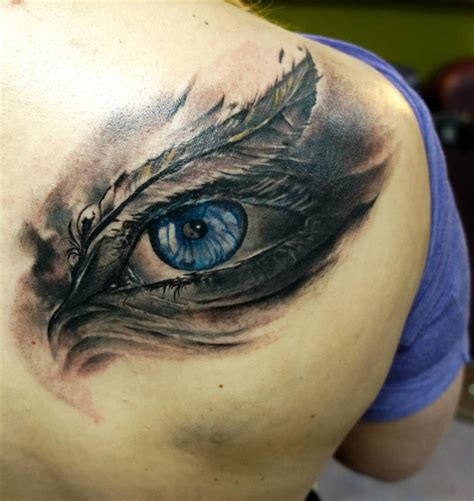 tattoo feather with eye tattoo by domantas parvainis at totemas tattoo in saiuliu