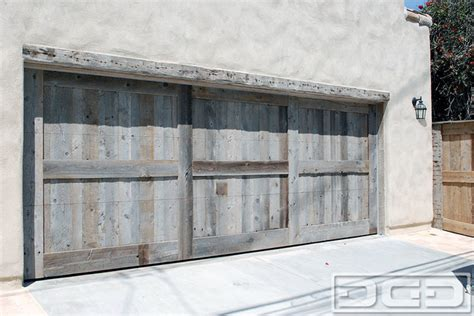 Garage Door Opener For Barn Doors Custom Made Reclaimed Barn Wood Garage Doors In A Tuscan