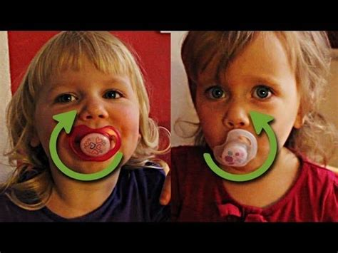 funny twins turning baby pacifier in mouth competition