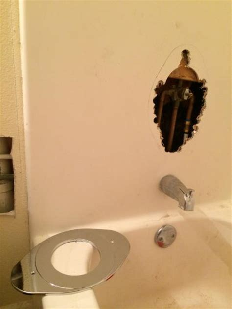 fixing a hole in a bathtub fix whole in bathtub near faucet doityourself com