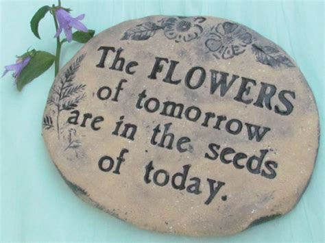 Garden Rocks With Sayings Garden With Gardening Quote The Flowers Of
