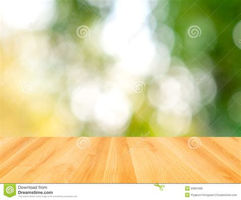 table background color wood table and green bokeh nature background stock photo