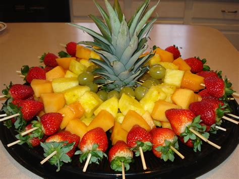 fruit skewers for a party cut top off of pineapple to