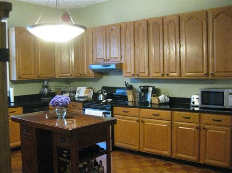 Best Color Countertop For Oak Cabinets by Black Countertops With Golden Oak Cabinets Black