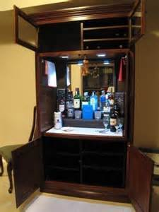 how to repurpose an outdated tv armoire liquor cabinet